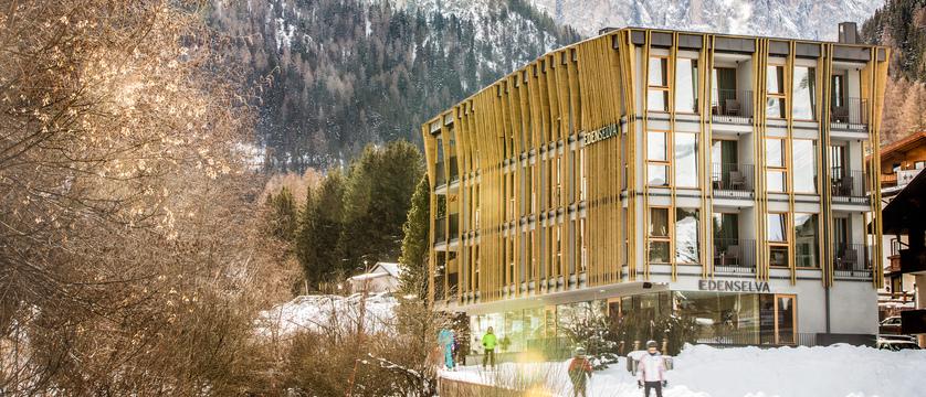italy_dolomites_selva_mountain-design-hotel-eden_exterior-with-skier.jpg